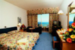 Golden Coast Hotel Bedroom, click on this photograph to enlarge
