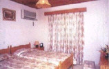 kotzias_apartments_bedroom.JPG (10953 bytes)